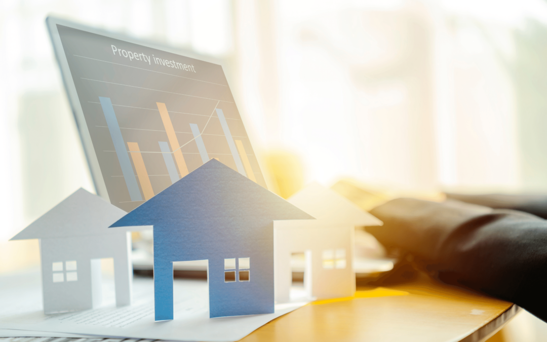 A mortgage investor looking at investments on a laptop - Mortgage Financing and Real Estate Investing